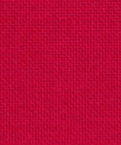 A close up on the texture of eighteen count aida fabric, the holes are clearly visible. The colour is red