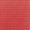 A closeup of Antique Red coloured perforated paper for cross stitch. It is a rich red, not too bright.